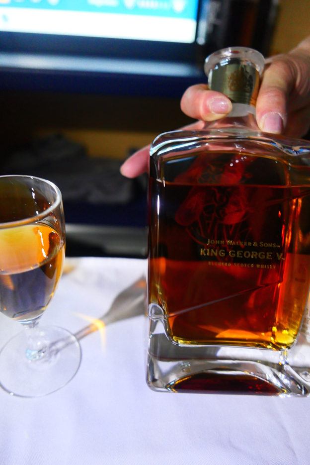 Glass of Kinge George V. blended scotch whiskey